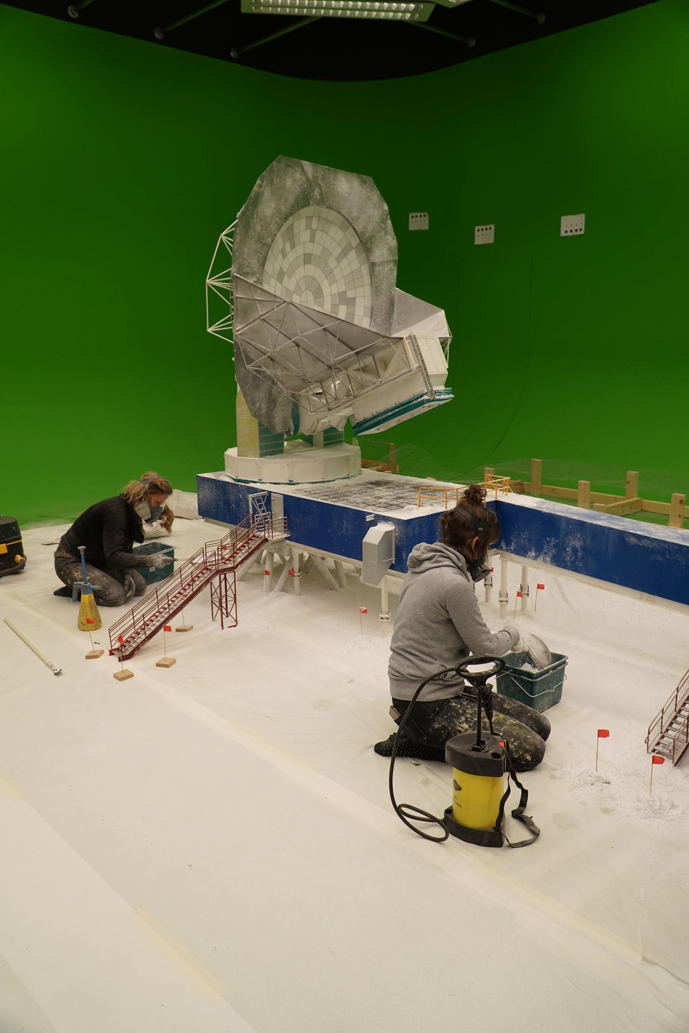 E&S effects technicians work on a scale model of the South Pole Telescope for the fulldome show Black Hole First Picture